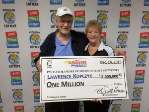 Lawrence Kopczyk poses for a photo with his wife, Pat, after collecting a $1 million Mega Millions prize.