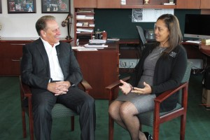 Courtney Valentine talks with Michigan State University basketball coach, Tom Izzo, after accepting her Excellence in Education award.