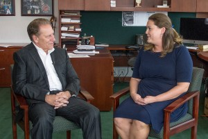 Jessica Provoast talks with Michigan State University basketball coach, Tom Izzo, after accepting her Excellence in Education award.