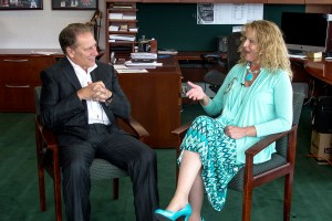 Karen Ricketts talks with Michigan State University basketball coach, Tom Izzo, after accepting her Excellence in Education award.