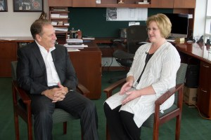 Kimberly Keith talks with Michigan State University basketball coach, Tom Izzo, after accepting her Excellence in Education award.