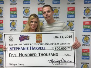Stephanie Harvell poses for a photo with her husband, Mitchell, after claiming her $500,000 Hot Jackpot prize.