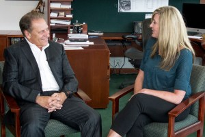 Jacqueline Dolce talks with Michigan State University basketball coach, Tom Izzo, after accepting her Excellence in Education award.