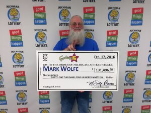 Mark Wolfe smiles after collecting a $131,496 Fantasy 5 jackpot.