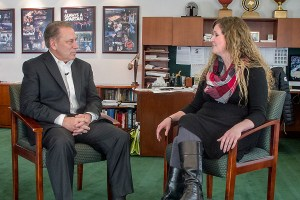 Ashley Bowen talks with Michigan State University basketball coach, Tom Izzo, after accepting her Excellence in Education award.
