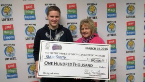 Gabe Smith poses for a photo with his mom after collecting his $100,000 Bonus Ball Bingo prize.