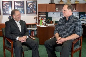Joseph Churches talks with Michigan State University basketball coach, Tom Izzo, after accepting his Excellence in Education award.