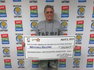 Mitch Gillons smiles after collecting a $223,916 Fantasy 5 jackpot.