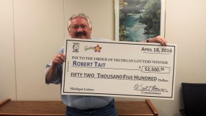 Robert Tait smiles after collecting his Fantasy 5 jackpot from the Michigan Lottery.