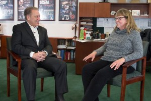 Kathleen McNulty talks with Michigan State University basketball coach, Tom Izzo, after accepting her Excellence in Education award.