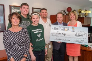 Kari Roy (right) poses for a photo with (left to right) Herbison Woods Elementary principal, Vicky Milner, son, Lucas, daughter, Karly, and husband, Dan, after accepting her Excellence in Education award from Michigan State University basketball coach Tom Izzo.