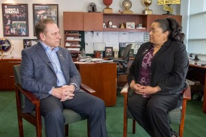 Lisa Boulding talks with Michigan State University basketball coach, Tom Izzo, after accepting her Excellence in Education award.