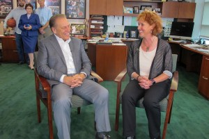 Alyona Troitsky talks with Michigan State University basketball coach, Tom Izzo, after accepting her Excellence in Education award.