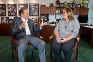 Beth Eggleston talks with Michigan State University basketball coach, Tom Izzo, after accepting her Excellence in Education award.