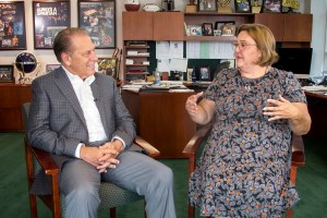 Jennifer Black talks with Michigan State University basketball coach, Tom Izzo, after accepting her Excellence in Education award.