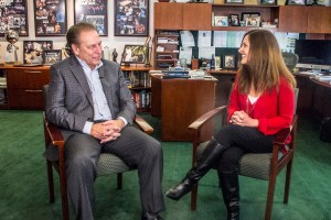 Julie Dillon talks with Michigan State University basketball coach, Tom Izzo, after accepting her Excellence in Education award.