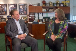 Michelle Schwendemann talks with Michigan State University basketball coach, Tom Izzo, after accepting her Excellence in Education award.