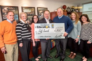 Jeff Sewick poses for a photo with (left to right) his father, Robert Sewick, mother, Gail Sewick, third grade teachers, Katie Dufresne, and Devon Detmers, and teaching partner, Jamie McKennon, after accepting his Excellence in Education award from Michigan State University basketball coach Tom Izzo.
