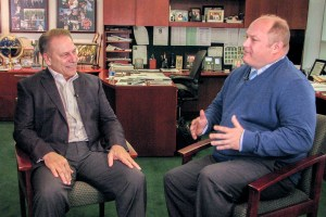 Jeff Sewick talks with Michigan State University basketball coach, Tom Izzo, after accepting his Excellence in Education award.