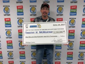 Timothy H. McMurtrie smiles after collecting a $1.15 million Lotto 47 jackpot.