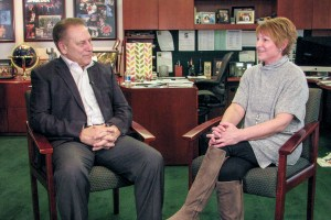 Sue Meier talks with Michigan State University basketball coach, Tom Izzo, after accepting her Excellence in Education award.