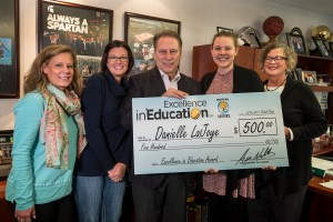 Danielle LaJoye poses for a photo with (left to right) Dean of Students, Robin Seniura, nominating parent Meagan Fisch, and mother Diane Hoskins, after accepting her Excellence in Education award from Michigan State University basketball coach Tom Izzo.