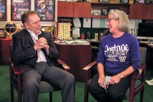 Linda Holzwarth talks with Michigan State University basketball coach, Tom Izzo, after accepting her Excellence in Education award.