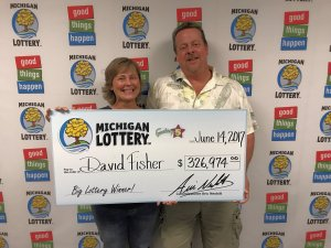 David Fisher and his sister, Donna, smile after he collected a $326,974 Fantasy 5 jackpot.