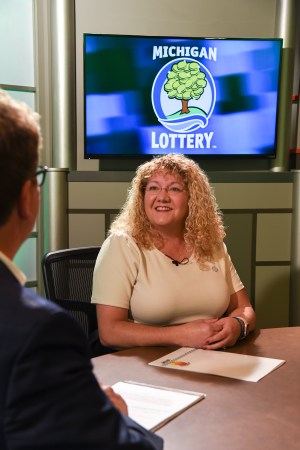 Gina Russell is interviewed after being presented with an Excellence in Education award from the Michigan Lottery.
