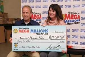 Mega Millions jackpot winners, Kevin and Stephanie Blake, pose for a photo after speaking with media members on Oct. 25, 2017.