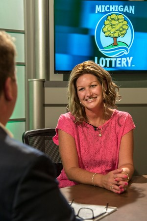 Nikki Simons is interviewed after being presented with an Excellence in Education award from the Michigan Lottery.