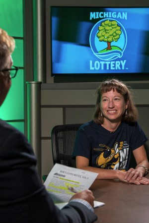 Lisa Yoder is interviewed after being presented with an Excellence in Education award from the Michigan Lottery.