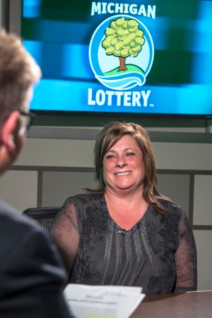 Beth Quimby is interviewed after being presented with an Excellence in Education award from the Michigan Lottery.