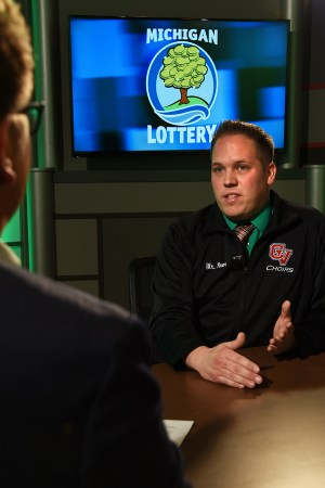 James Pecar is interviewed after being presented with an Excellence in Education award from the Michigan Lottery.