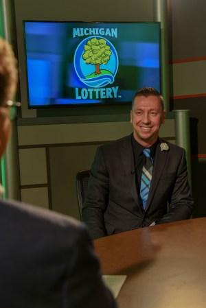 Trevor Szafranski is interviewed after being presented with an Excellence in Education award from the Michigan Lottery.
