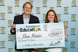 Elaine Mahabir poses for a photo with Michigan Lottery Commissioner, Aric Nesbitt, after accepting her Excellence in Education Award.