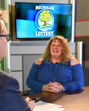 Cheryl Evers is interviewed after being presented with an Excellence in Education award from the Michigan Lottery.
