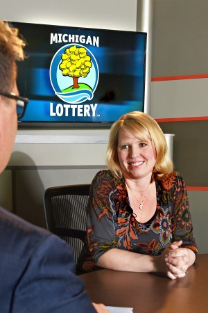 Jennifer Grubb is interviewed after being presented with an Excellence in Education award from the Michigan Lottery.