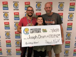 Joseph Drum (right) poses for a photo with sons, Brandon (left) and Aden (center), after claiming a $170,842 Black Jack Fast Cash jackpot.