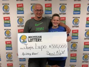 Jamie Lupo and his wife, Alicia, smile after collecting a $500,000 Lottery prize.