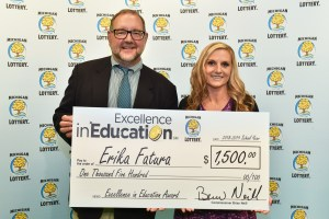 Erika Fatura poses for a photo with Michigan Lottery public relations director, Jeff Holyfield, after accepting her Excellence in Education Award.