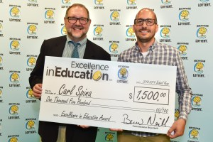 Carl Spina (right) poses for a photo with Michigan Lottery public relations director, Jeff Holyfield, after accepting his Excellence in Education Award.