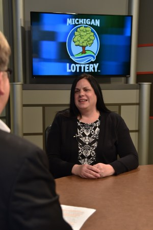 Lila King is interviewed after being presented with an Excellence in Education award from the Michigan Lottery.