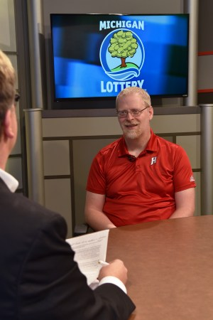 Bill Boerman is interviewed after being presented with an Excellence in Education award from the Michigan Lottery.