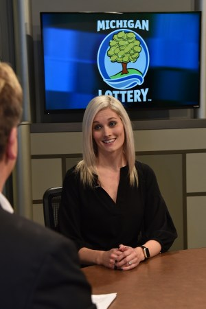 Kaitlin Merpi is interviewed after being presented with an Excellence in Education award from the Michigan Lottery.