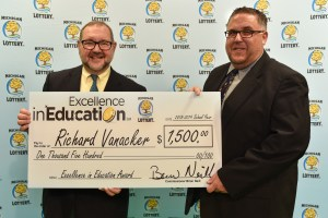 Richard VanAcker (right) poses for a photo with Michigan Lottery public relations director, Jeff Holyfield, after accepting his Excellence in Education Award.