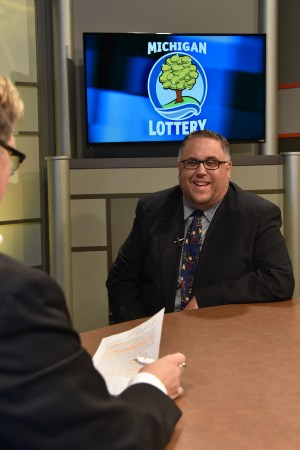 Richard VanAcker is interviewed after being presented with an Excellence in Education award from the Michigan Lottery.