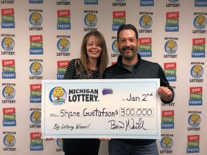 Shane Gustafson and his wife, Connie, smile after collecting their $300,000 Peppermint Payout prize.