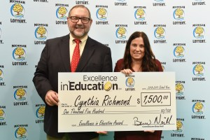 Cynthia Richmond (right) poses for a photo with Michigan Lottery public relations director, Jeff Holyfield, after accepting her Excellence in Education Award.