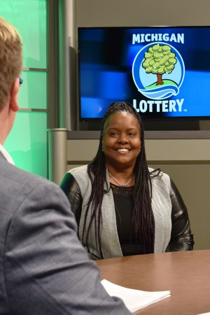Consuelo Brewer is interviewed after being presented with an Excellence in Education award from the Michigan Lottery.